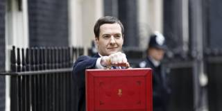 George Osborne, U.K. chancellor of the exchequer, holds the dispatch box containing the 2015 budget as he stands outside 11 Downing Street in London, U.K., on Wednesday, June 8 2014. Photographer: Simon Dawson/Bloomberg via Getty Images
